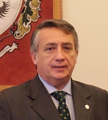 Dr. Carlos I.